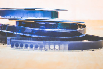museum exhibit: bobbins with an old film, a film shot on a film,  retro