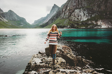Traveler woman walking at sea in Norway Travel lifestyle survival emotional concept adventure outdoor active vacations wild scandinavian nature