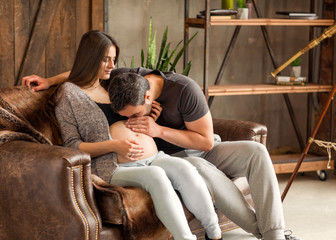 Couple in love pregnant cuddling, waiting for baby