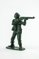 Classic green toy army soldier aiming his gun.