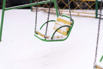 Playground in winter with snow