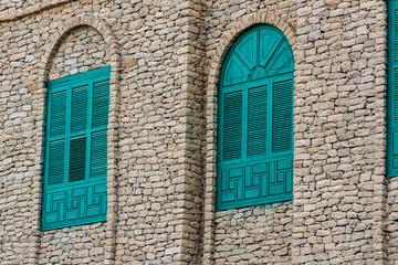 traditonal house built from stones and wooden windows in Hejaz in Saudi Arabia