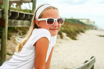 Girl with sunglasses at beach