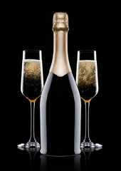 Elegant glasses and bottle of yellow champagne