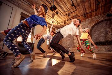 Professional people exercising dance training in studio