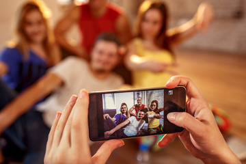 Break dance, freestyle, hip-hop and street dance concept- picture of smiling dancer friends on smartphone