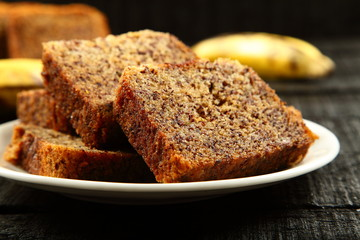 delicious banana cake on a rustic wooden table.