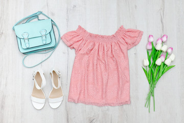 Pink blouse, white shoes, handbag and a bouquet of tulips. Fashionable concept.