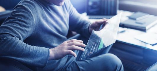 Wall Mural - Man with futuristic digital tablet