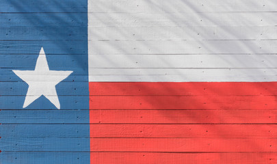 Texas flag pattern on wooden board texture. Vintage painted Lone Star State symbol texture on grunge wall fence. Room for text, copy space