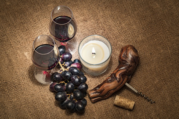 Red wine in a glass with grape