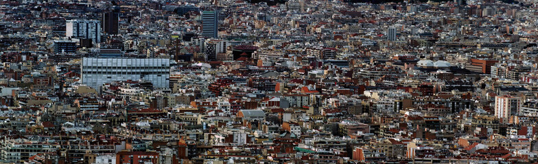 panoramic aerial cityscape view of the barcelona cityscape showing densely crowded buildings towers and streets