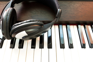 Headphone on piano keyboad. Art and music background.
