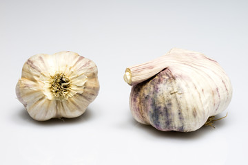 Tasty healthy garlic on white isolated substrate. Vegetables on a white table.