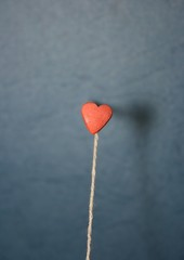 Heart shaped balloon. Flat lay. Selective focus. Minimal concept.