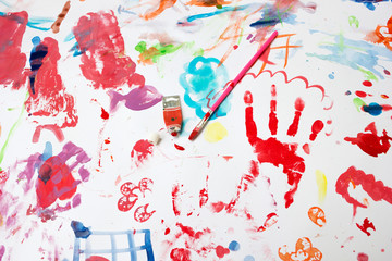 Child's painting in a white paper with water colors and brush (equipment of painting) .