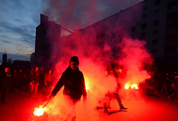 Demonstrators march with flares during an anti-fascism demonstration in Milan