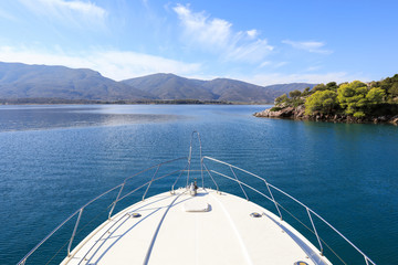 Summer time a beautiful yacht anchoring in Love bay Poros island Greece.