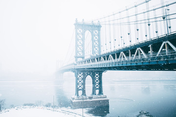 Manhattan Bridge over East River during winter