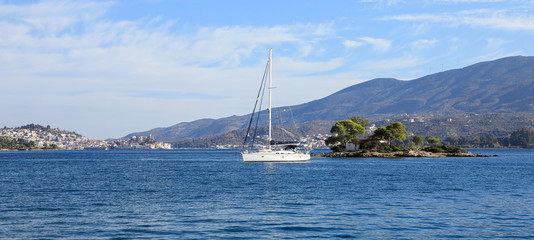 Summer time a beautiful sailboat anchoring in Love bay Eros island or Daskalio near Poros island Greece.