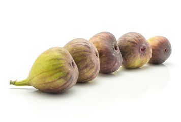 Five figs isolated on white background fresh ripe purple green in row.