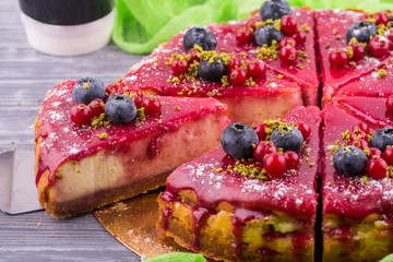 Specialty cheesecake with fresh berries in berry sauce