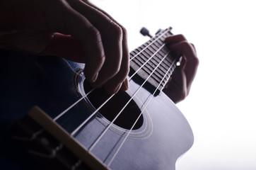 playing the ukulele closeup isolated on white