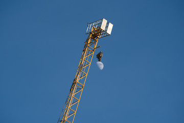 illusion of moon hanging from crane