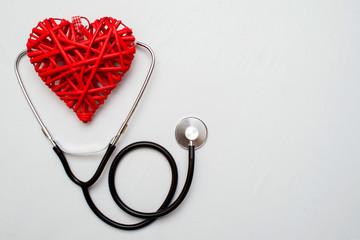 Medicine. Pressure sensor, heart shape, stethoscope and dollars on a wooden background, copyspace