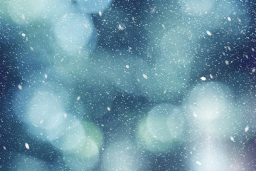 Wall Mural - Blue Winter Outdoor Abstract Blurred Light Bokeh Nature Background Texture with White Falling Snow, Horizontal