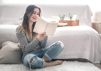 the girl is reading in the living room