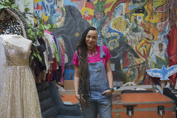 Portrait of smiling young woman standing in art studio