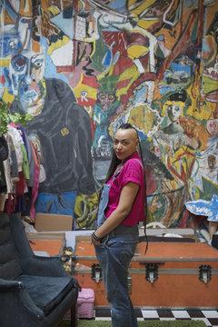 Portrait of young woman standing in art studio