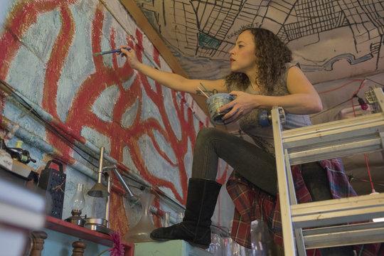 Young female artist working in art studio
