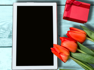 Tulips with mockup and gift, 8 march. Beautiful greeting card.