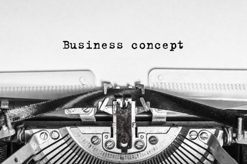Business concept text typed on an old typewriter. vintage thing. Close-up