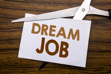 Hand writing text caption inspiration showing Dream Job. Business concept for Dreaming About Career Written on note, wooden back with colourful scissors meaning destroy stop of something.