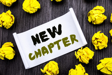 Writing text showing New Chapter. Business concept for Starting New Future Life Written on sticky note notepad note notebook book wooden background with yellow sticky folded.