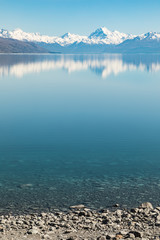 Mount Cook reflected in the blue waters of Lake Taupo, New Zealand
