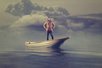 Young man in a boat at sea