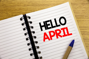 Word, writing Hello April. Business concept for Spring Welcome written on notepad with copy space on old wood wooden background with pen marker