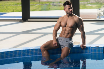 Athlete At Hotel Indoor Pool