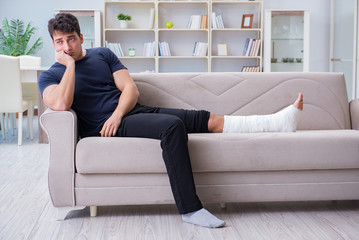 Man with broken leg recovering at home
