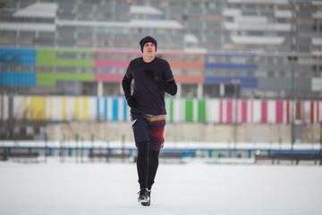 Photo of running athlete in stadium