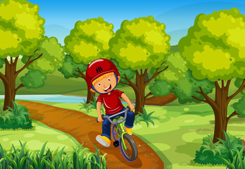 Little boy riding bike in the park