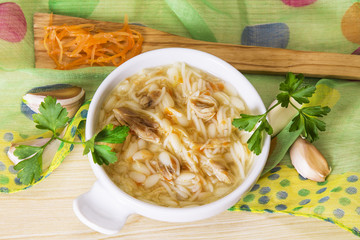 noodle soup and chicken with carrot and garlic