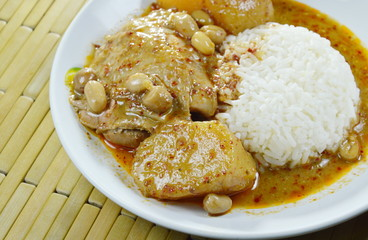 chicken curry and potato with rice on plate