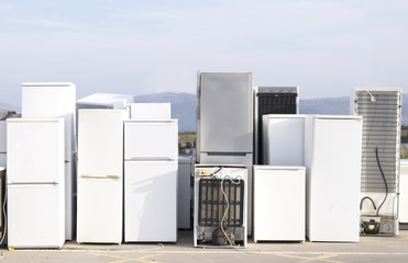 Old fridges freezers refrigerant at refuse dump skip recycle plant help environment