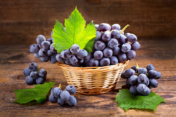 fresh grape with leaves in a basket