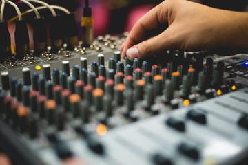 close up hand tuning sound mixer